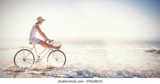Woman riding bike in the sea