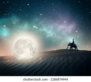 Woman riding an elephant and discovers a fallen moon.