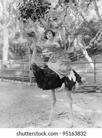 Woman riding ostrich