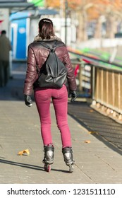 Woman is riding rollerblades in autumn in germany cologne 2018.