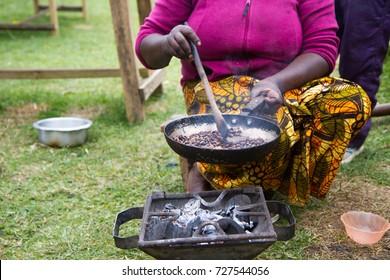 woman roasting coffee in a traditional way in arusha tanzania