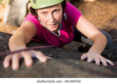 Woman rock climbing on the nature