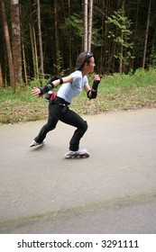 Woman roller blading in a demonstration forest built for no vehicles