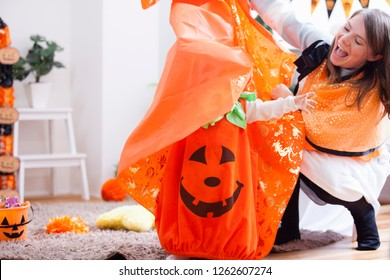 Woman in a room decorated Halloween