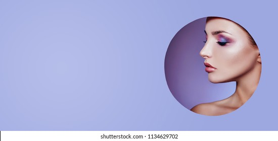 Woman in a round hole circle in purple background, Beauty makeup cosmetics nature fashion, copy space advertising. Professional makeup perfect skin and shiny lipstick. Advertising banner, book cover