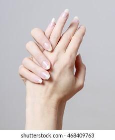 Woman rubbing cream in hands