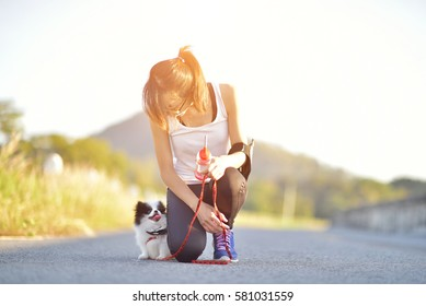 woman runner and puppy
