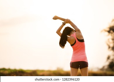 Woman runner stretch before exercise.