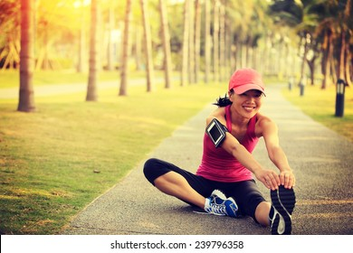 woman runner stretching legs outdoor
