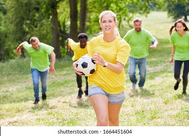 Woman is running a ball in a competition at the teambuilding workshop