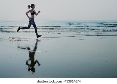 Woman Running Beach Morning Exercise Concept