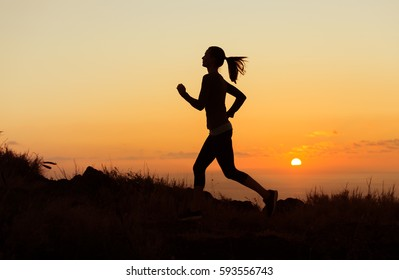 Woman running early morning.