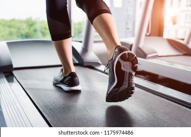 Woman running exercise on track treadmill at fitness gym