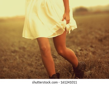 Woman running in the field in autumn