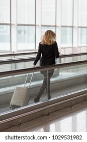 Woman running to the gate at the airport