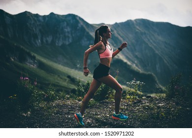 Woman running and jogging in the nature mountain scenery. Concept of healthy lifestyle. Fitness spot girl training in mountain.