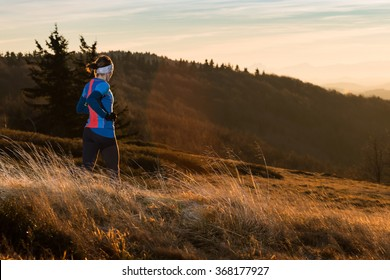 woman running and jogging in the nature mountain scenery in the cold spring morning