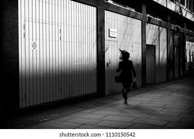 Woman running, London, England