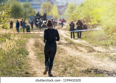 Woman running a marathon in nature