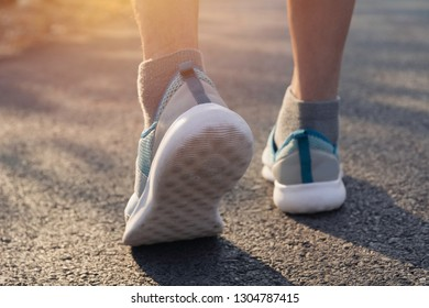A woman running at the morning for jogging, exercising and healthy lifestyle concept.