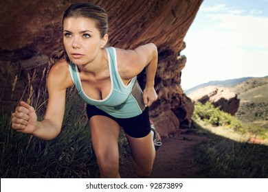 Woman running in the mountains