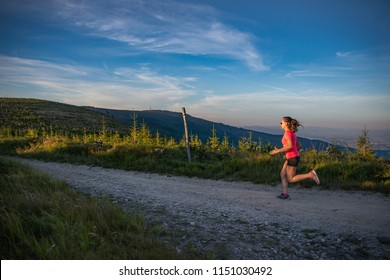 Woman running in mountains. Woman trail runner. Szczyrk, Beskidy Mountains, Poland
