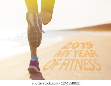 Woman running on the beach. Concept of new years resolution to get fit.