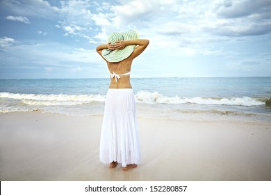 Woman running on the beach. Vacation.