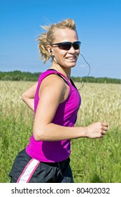 Woman running on country road in summer nature, blurred motion