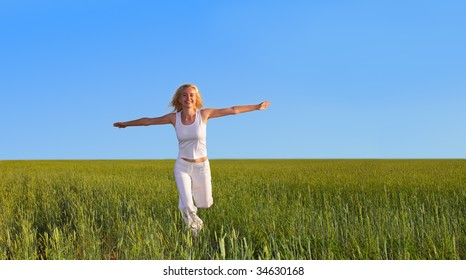 Woman running on a meadow
