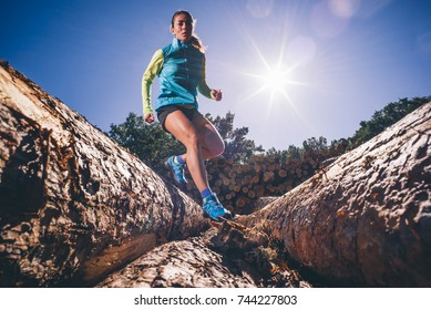 Woman running on the mountain. Area of Madrid Spain.