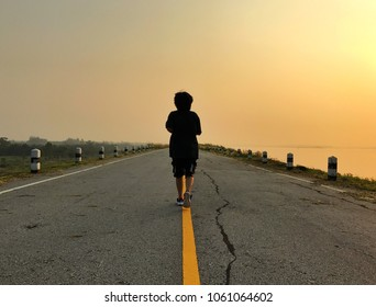 Woman running on the road, Jogging workout wellness concept.
