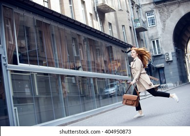 woman is running on the street