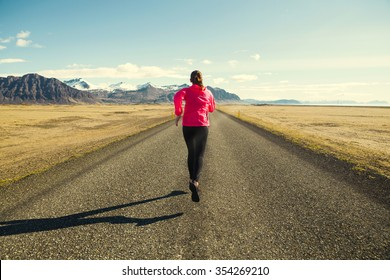 Woman running on a winter day