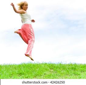 woman running over grass