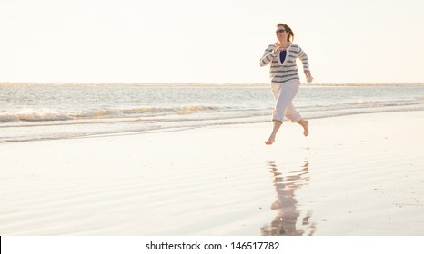 Woman Running Playfully on the Beach