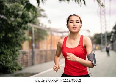 woman running in run lane in city.