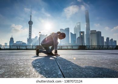 Woman running at Shanghai bund in the morning,landmark of Shanghai