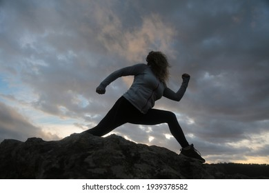woman with running silohuette in the mountain with background sky with clouds