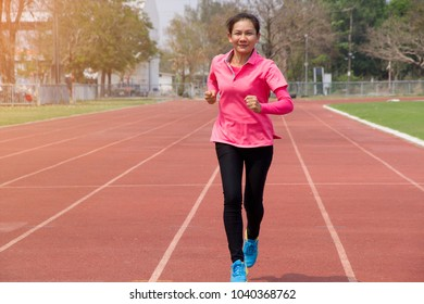 Woman running in track - Sport Concept