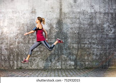 Woman running in urban area