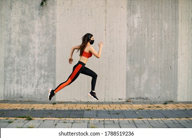 Woman running wearing mask for protection