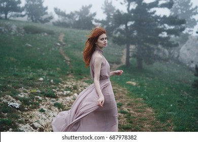 The woman is running in the woods