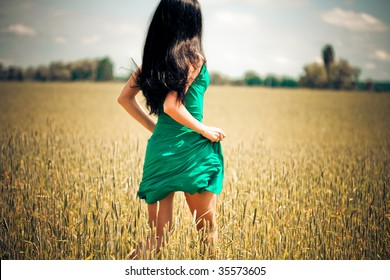 woman running in yellow field