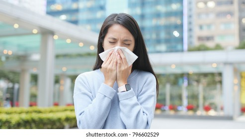 Woman runny nose at outdoor