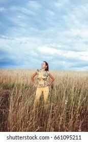 A woman in a rye field