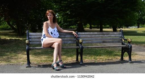 woman sad on bench