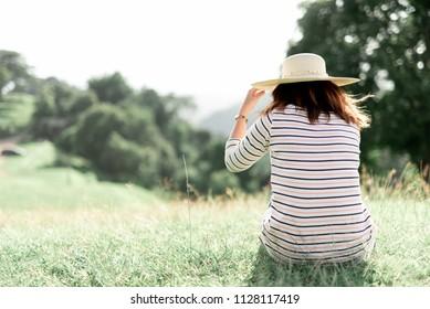 woman sad on the mountain