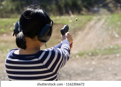 A woman safely praqctices shooting a pistol at a range in north Idaho.