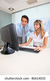 Woman and sales manager in office with headset on